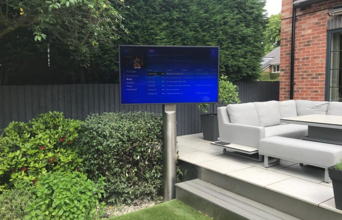 Outdoor TV on a moveable, rotating stand makes the perfect setup for watching from the lawn or patio.